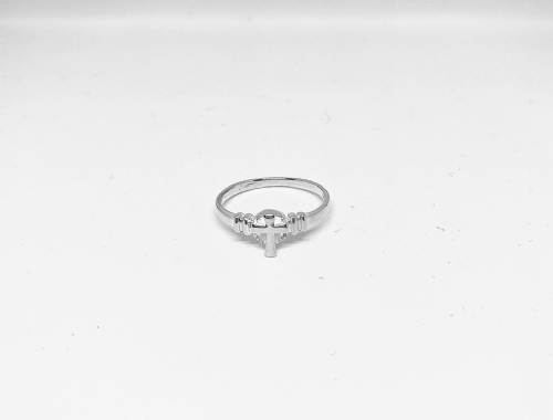 Silver ring with small cross
